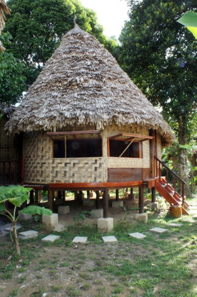 Thatch-roofed houses and wood carving reveals their relationship to some Malay cultures