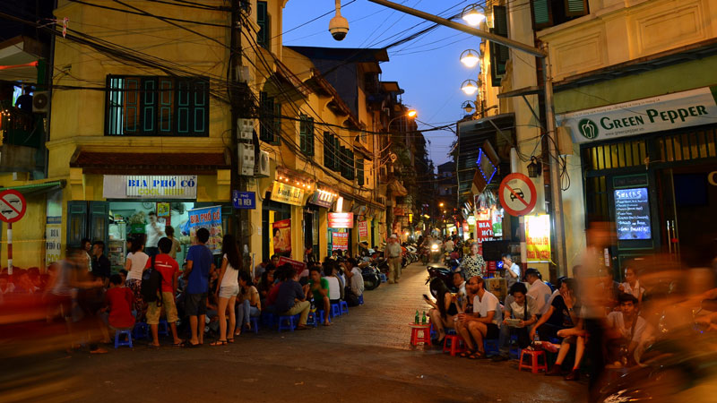 Drinking with locals on small plastic chairs in Hanoi